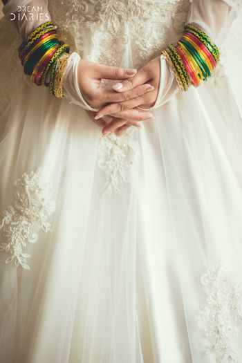 Photo of Green and yellow bangles over white gown