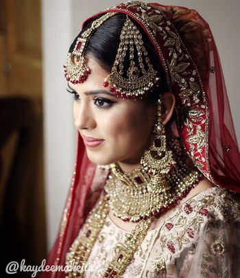 Bridal jewellery with red beads and jhoomer