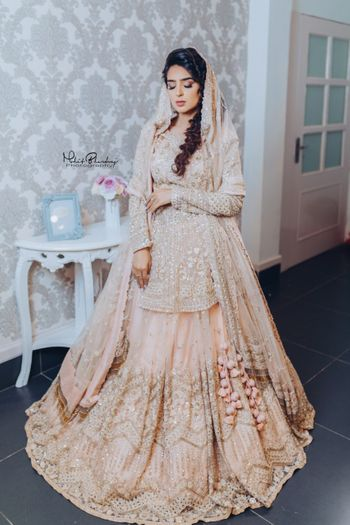 peach bridal lehenga with peplum blouse