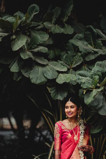 South indian bridal hairdo with flowers all over
