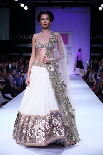 Photo of Anushree Reddy white and silver foil lehenga