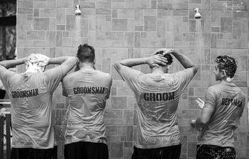 Fun groomsmen photo with customised tees