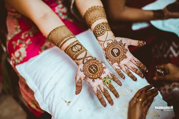Photo of Modern bridal mehendi design with monograms