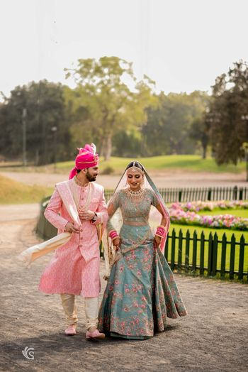 Offbeat bride and groom outfits for destination wedding