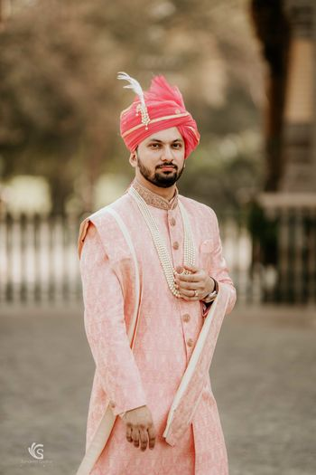 Light pink sherwani with brighter safa
