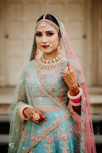 Blue and pink embroidered offbeat bridal lehenga