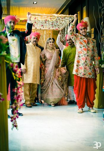 Photo of Bridal entry under phoolon ki chaadar