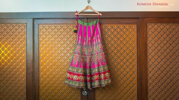 Photo of rani pink and sea green lehenga