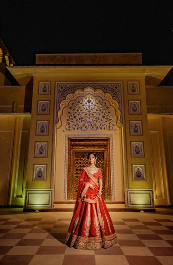 Red and gold bridal lehenga bridal portrait