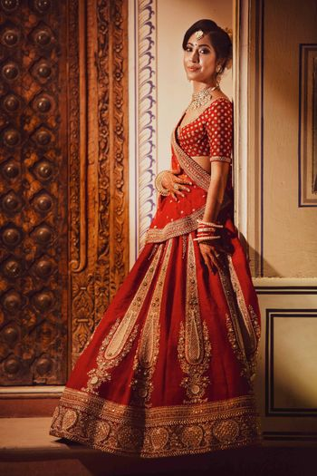 Minimal bridal lehenga with red and gold work