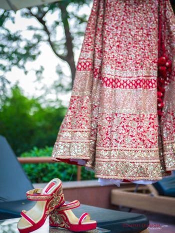 Photo of Red intricate bridal lehenga