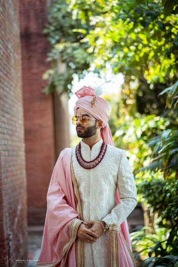 Photo of Groom in ivory sherwani with matching safa and stole