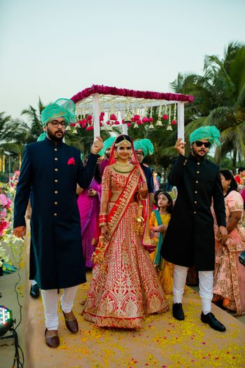 Bridal entry with matching bridesmen in green safas