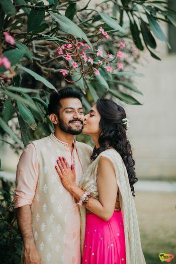 Cute couple portrait bride kissing groom
