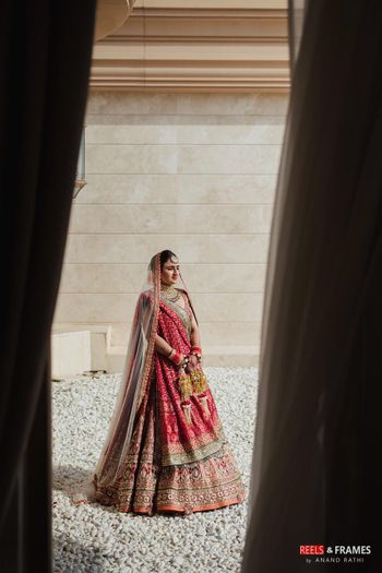 red and gold bridal lehenga with lots of embroidery