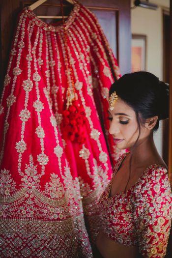 Bride with lehenga shot on hanger