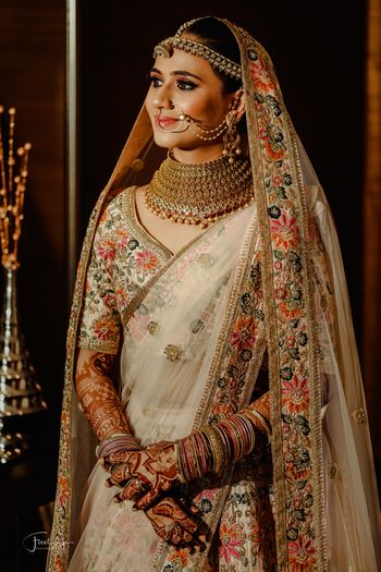 Floral work embroidery lehenga in white