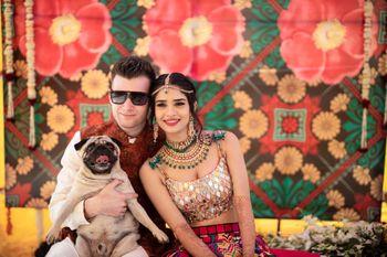 Couple portrait on mehendi with dog