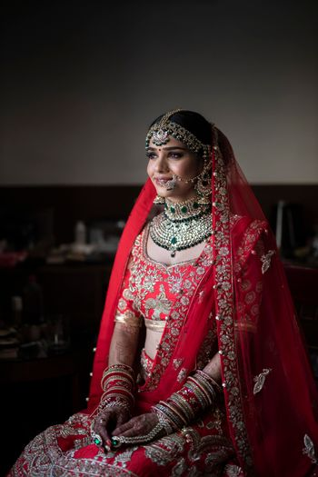 North Indian bride in red lehenga and contrasting jewellery
