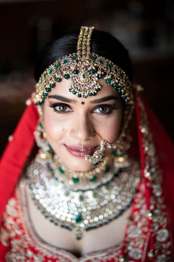 Bridal mathapatti and nath with green beads
