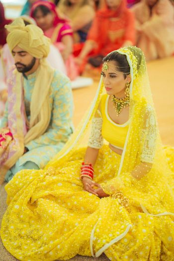 Photo of Bright yellow wedding lehenga for bride