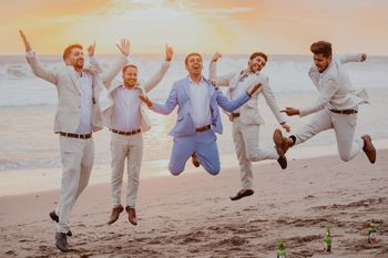 Photo of Jumping shot of groom with groomsmen