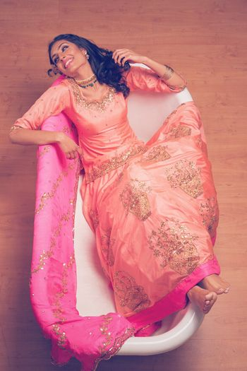 Photo of Peach and Gold Lehenga with Pink Dupatta