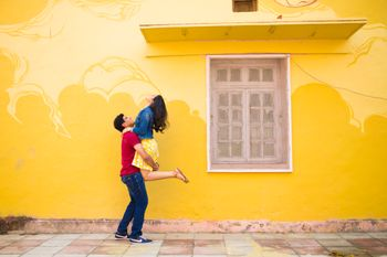 Photo of Pre wedding shoot infront of Yellow Wall