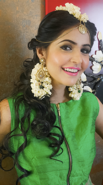 Photo of Floral white jewellery on bride, side swept curls hairstyle
