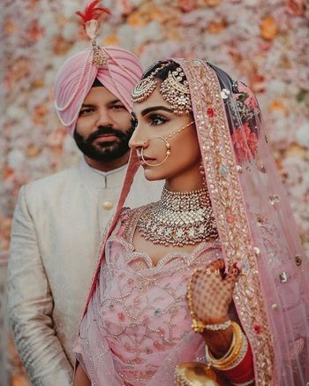 Sikh couple in light pink outfits and unique jewellery