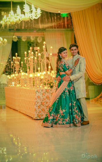 Couple Portrait with Candle Stands and Chandelier