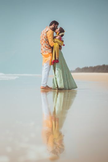Photo of Couple on beach wedding kissing shot