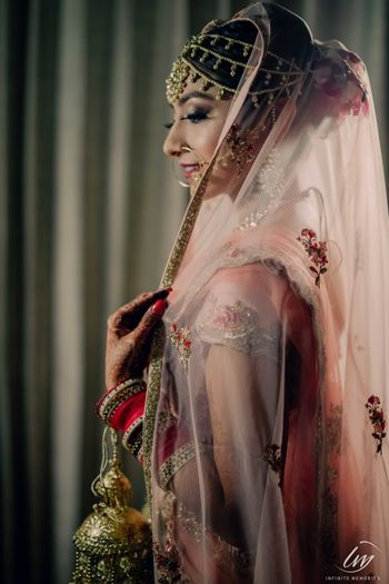 A bride smiling through her veil.
