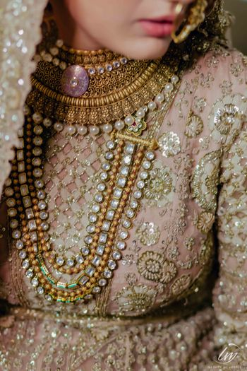 Layered bridal jewellery with high neck blouse