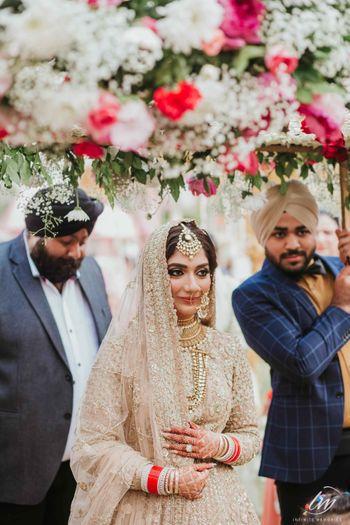 Bride in silver under phoolon ki chadar