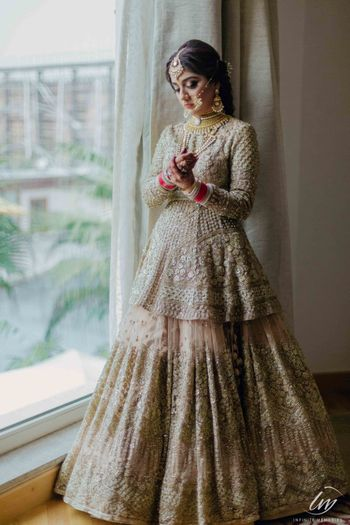 Silver bridal lehenga with a peplum blouse
