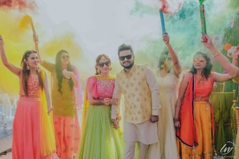 Mehendi couple entry with guests holding smoke sticks
