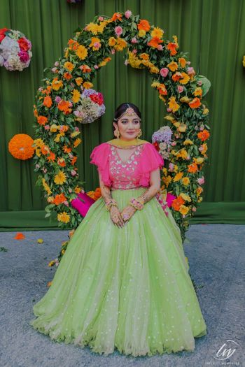 Bright pink and light green lehenga for mehendi on bride