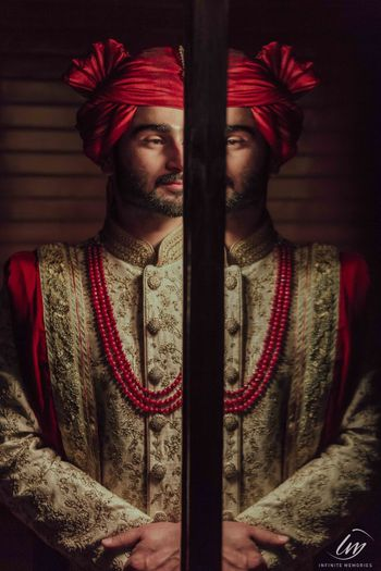 Modern groom portrait in red safa and necklace