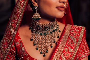 Dark green choker necklace with red lehenga