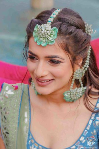 Funky mehendi floral jewellery with maangtikka and earrings