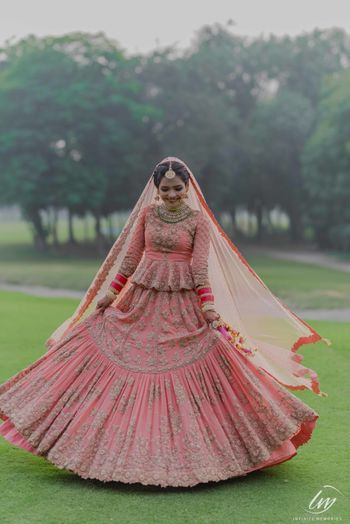 Offbeat peach bridal lehenga with peplum blouse
