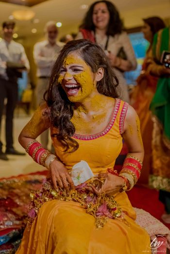 Bride on haldi in DIY yellow outfit