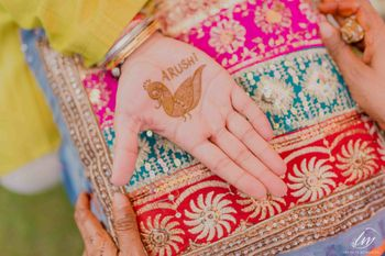 Grooms mehendi with brides name and peacock
