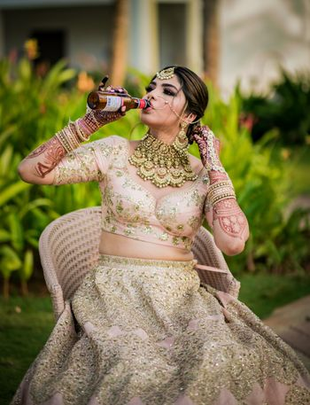 Bride with alcohol bottle in her hand