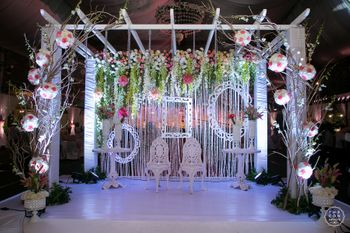 Photobooth with white frames hanging