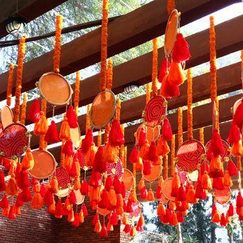 Orange Floral Damru Decor