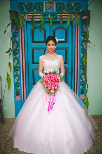 White Wedding Gown and Pink Wedding Bouquet
