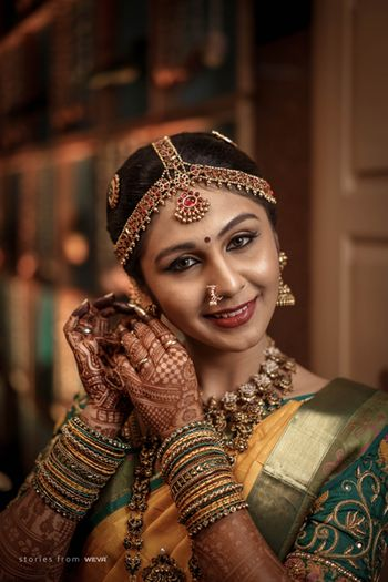 A happy South Indian bride on her wedding day.