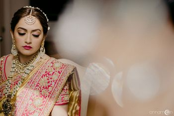 Wedding day bridal portrait with embroidered lehenga and pearl jewellery